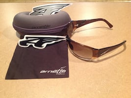 Brown arnette sports sunglasses with gray case, decal, and cloth NEW