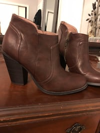 Pair of brown vegan leather booties Vancouver, V5Z 3M9