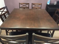 rectangular brown wooden table with four chairs dining set Mississauga, L5L 5V9