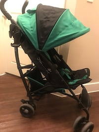 baby's green and black stroller 1165 mi