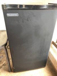 black and gray Haier compact refrigerator 2225 mi