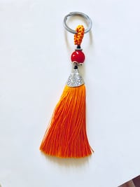 Keychain with orange tassel - brand new  New York, 11360