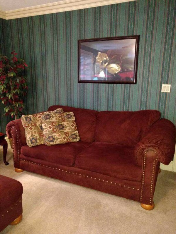 4 Piece Living Room Set with couch, loveseat, chair and ottoman. Real good  quality furniture. Color is Burgundy