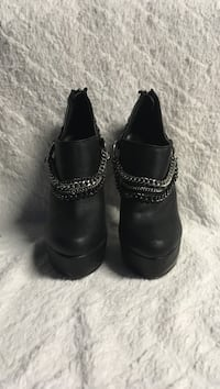 pair of black leather boots Los Angeles, 91342