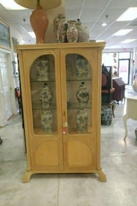 brown wooden framed glass display cabinet Hagerstown, 21740