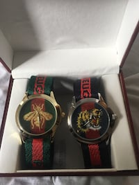 two round black analog watches with black and red straps Hamilton, L9B 2J7