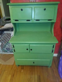 green wooden 3-drawer chest