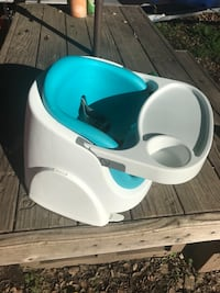 white and blue space saver highchair