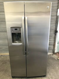 silver side-by-side refrigerator with dispenser League City, 77573