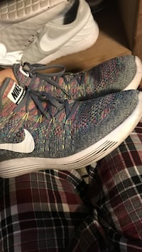 pair of gray-white-and-green Nike sneakers