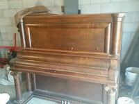 Antique  Piano and bench seat 960 mi