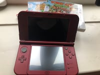 red Nintendo 3DS with game cartridge 553 km
