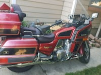 red and black touring motorcycle Sioux Falls, 57104
