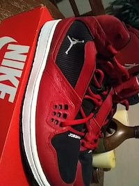 red-and-black Air Jordan basketball shoes with box