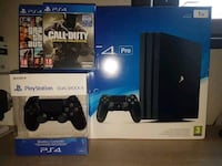 Sony PS4 console with controller and game cases PHOENIX