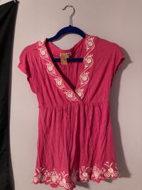 Pink shirt with white embroidery