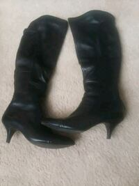pair of black leather heeled boots Denver, 80239