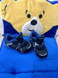 boy's pair of black-and-blue shoes