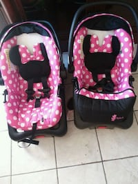 baby's pink and black car seat carrier Las Vegas, 89103