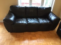Black leather couch -very comfy- some wear -two small patches holes Newmarket, L3X 2E4