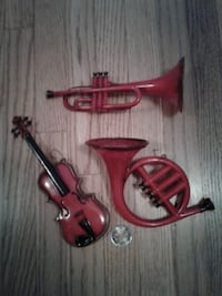 Plastic red trumpet, violin and french horn 546 km