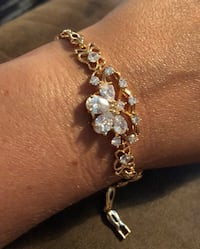 Beautiful gold colored bracelet with pretty designed flower   North Chesterfield, 23234