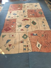 Brown and green area rug Dollard-des-Ormeaux, H9B