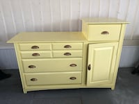 Yellow wooden 4-drawer dresser. Bought as a project piece and don't have time to do it. All drawers work.  South Pasadena, 33707