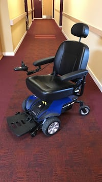 Black and blue motorized wheelchair Lakewood, 80214