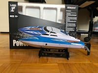 Blue and White RC Boat with controller and original box. Great condition used it about 6 times over the summer   Toronto, M3N 1A2