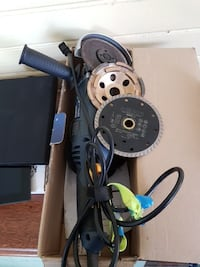 black and blue angle grinder with blades in box London, N6C 1C7