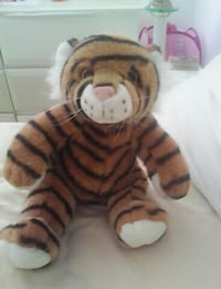 black and brown tiger plush toy Laval, H7N