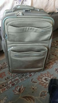 gray and black travel luggage 50 km