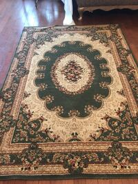 brown, white, and black floral area rug Aurora, L4G 7G4