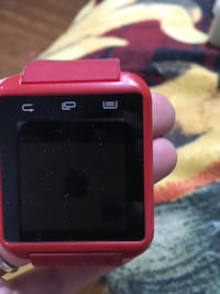 Red smartwatch with band