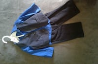 blue and black long-sleeved button-up shirt and black pants Miami, 33169