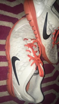 Pair of white-black-and-orange nike low-top sneakers Cookeville
