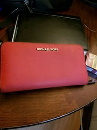 red Michael Kors leather wristlet 1966 km