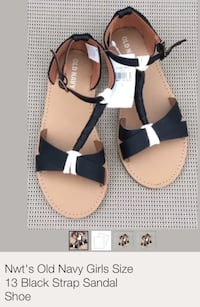 women's pair of black-and-brown Old Navy leather sandals