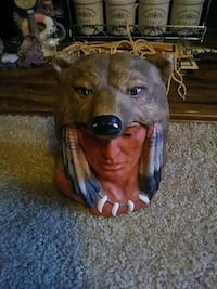 brown and black Native American headbust