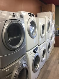 two gray front-load clothes washer and dryer set null