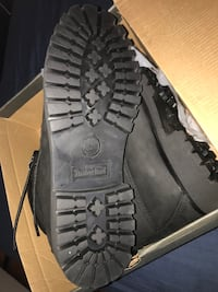 pair of black leather boots in box
