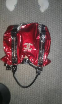 red and black leather handbag