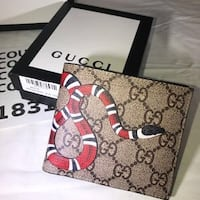 brown and black Gucci leather wallet Davie, 33314