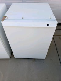 GE Mini fridge..price  firm..missing freezer door on small freezer  .