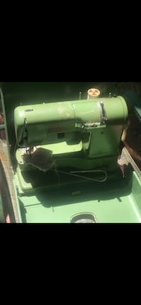 Elna supermatic with carrying case.  Victoria, V8T 4Y9
