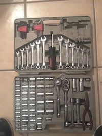 black and red handled screw with combination wrench and ratchet wrench set