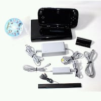 black Sony PS3 slim console with controller and game cases Regina, S4N 5E4
