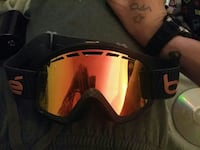 black and orange snow goggle