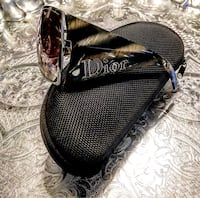 Christian Dior authentic Wide lenses with tortoise shell wide side arms Set in a chrome frames Made in Italy, #HUX94 135  Lens size: 7 x 6cm. Originally $425. The lenses have scratches on the front And needs to be adjusted. Good for the price Washington, 20002
